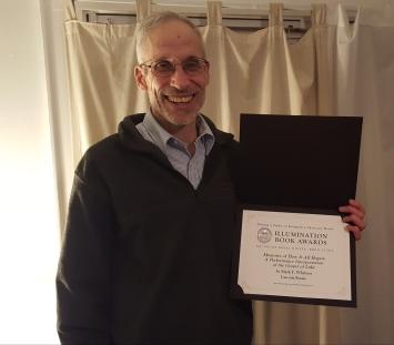 Mark holding the award
